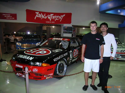 Mr. Tamura and Igor Sushko at the Prince Skyline Museum next to a Group A R32 Nissan Skyline GT-R