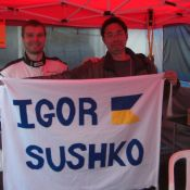 Igor Sushko with fan Satoshi and the custom-made banner!