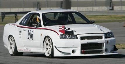 White R34 GT-R N1 on the track