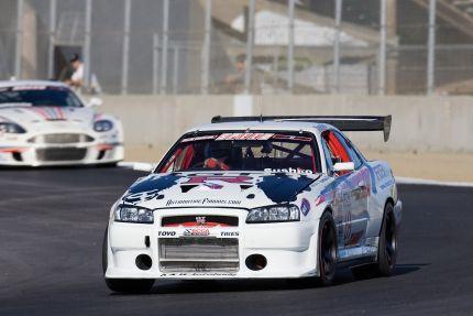 The AutomotiveForums.com R34 Nissan Skyline GT-R at Laguna Seca. Driver: Igor Sushko