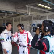 Maejima Shuji gets interviewed after his stint in the car at Suzuka.