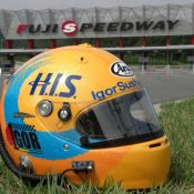 "Igor Sushko's newly designed helmet, featurng the ""1gor"" logo and the H.I.S. Travel Agency sponsor logo."
