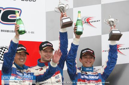 Igor Sushko, Masaaki Nagashima, and Kazuomi Komatsu on the podium at Fuji