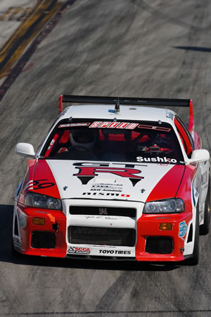 The AutomotiveForums.com's very own R34 Nissan Skyline GT-R racing at the Long Beach Grand Prix in April of 2006.